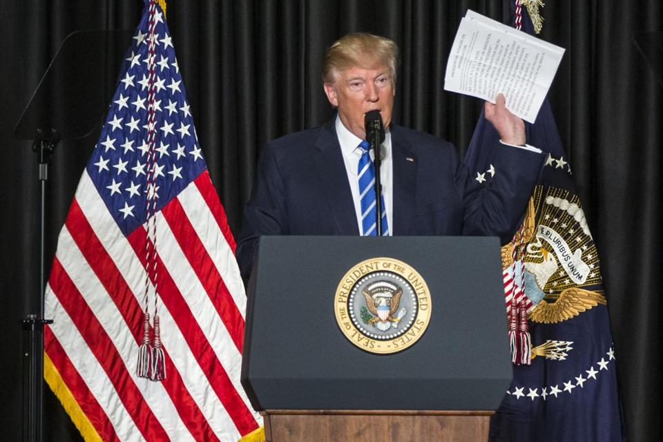 President Donald Trump speaks about the presidential powers of immigration while addressing the Major Cities Chiefs Association conference in Washington