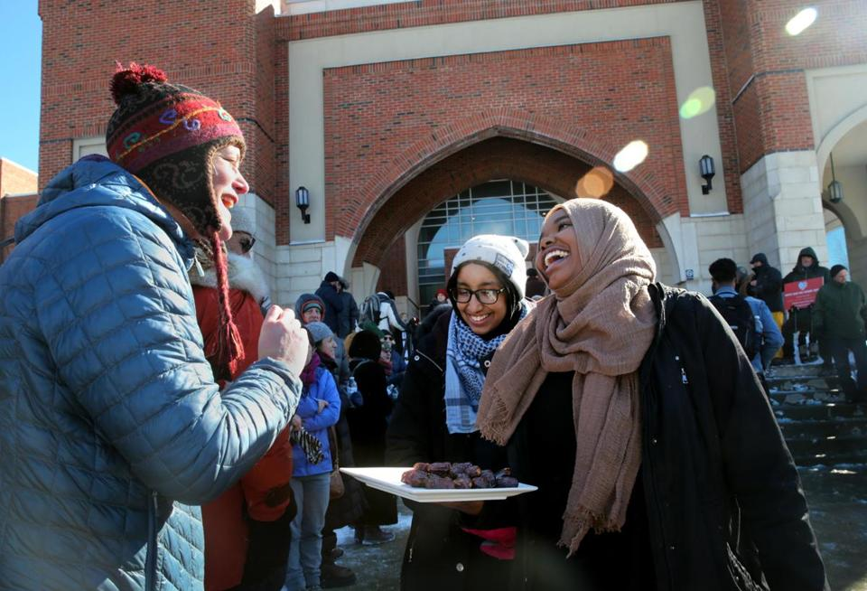 Sarah Kilgallon, of Watertown, accepted a date from worshippers Yusra Mukhtar and Nafisa Bilal outside the Islamic Society of Boston Cultural Center in Boston in February.