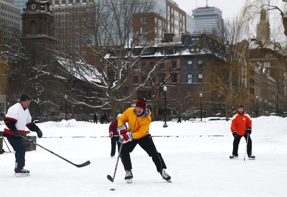 Boston, MA -- 2/12/2017 - A group played hockey on the pond in the public garden. (Jessica Rinaldi/Globe Staff) Topic: 13snow Reporter:
