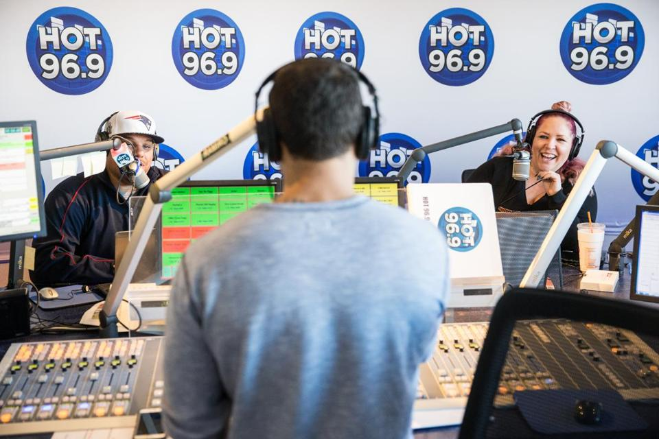 "From left: Jermaine ""Wiggy"" Wiggins, Ramiro Torres, and Melissa Eannuzzo broadcast Hot 96.9's Ramiro, Pebbles, Melissa, and Wiggy morning show."