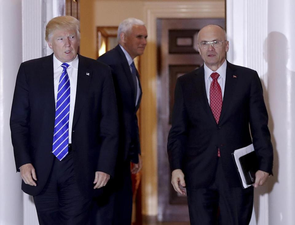 President-elect Donald Trump walks Labor Secretary-designate Andy Puzder from Trump National Golf Club Bedminster clubhouse in Bedminster, N.J., in November 2016.