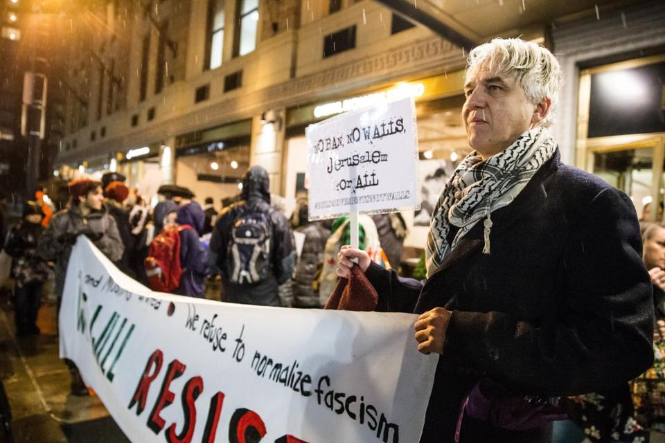 02/15/2017 BOSTON, MA Reins Rouner (cq) held signs outside the Boston Park Plaza during an interfaith rally against the Trump-Netanyahu meeting. (Aram Boghosian for The Boston Globe)