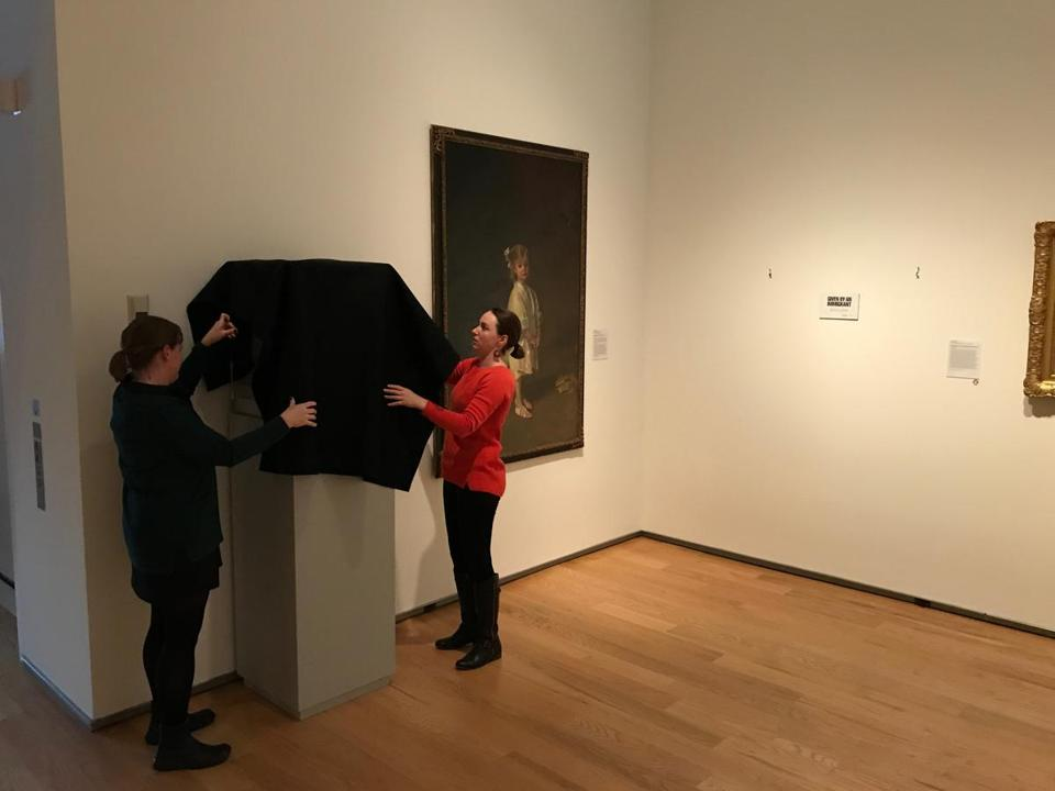 "The staff of the Davis Museum de-installs works as part of the ""Art-Less"" project."