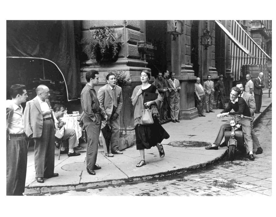 """American Girl in Italy"" by photographer Ruth Orkin was taken in Florence in 1951."
