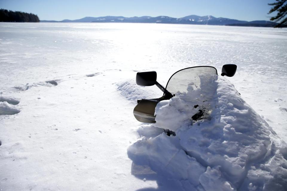 The snowmobile ridden by Steven Weiss, who managed to make it to shore when his machine broke through the ice. The two friends with him drowned.