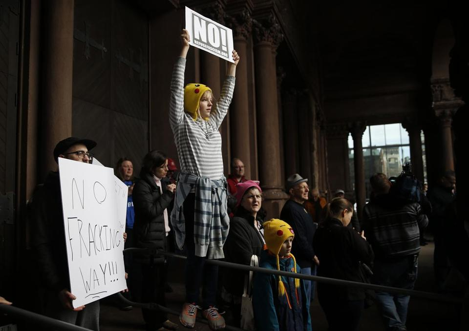 Grace Rodley, 13, of Scituate, held a sign as she, scientists, science advocates and community members rallied in Copley Square.