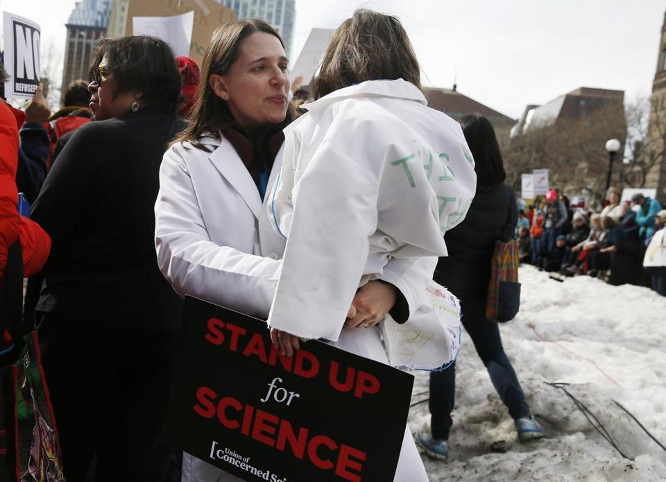 Heather Ferris, a Diabetes researcher from Newton, held her daughter, Paige Lester, 4, as they stood in Copley Square.