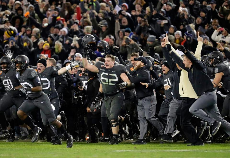 The Black Knights rushed the field after defeating the Midshipmen, 21-17, in