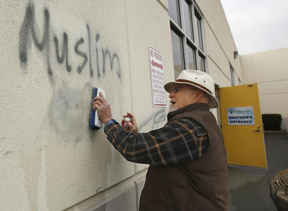 In February, Tom Garing cleans up racist graffiti painted on the side of a mosque in Roseville, Calif.