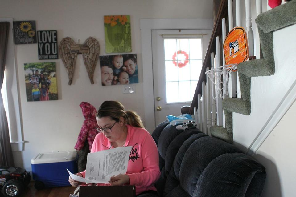 Lindsey Keane, a Woburn mother whose toddler son Noah died of traumatic head injuries while he was being cared for by a baby sitter, went through paperwork she keeps on file.