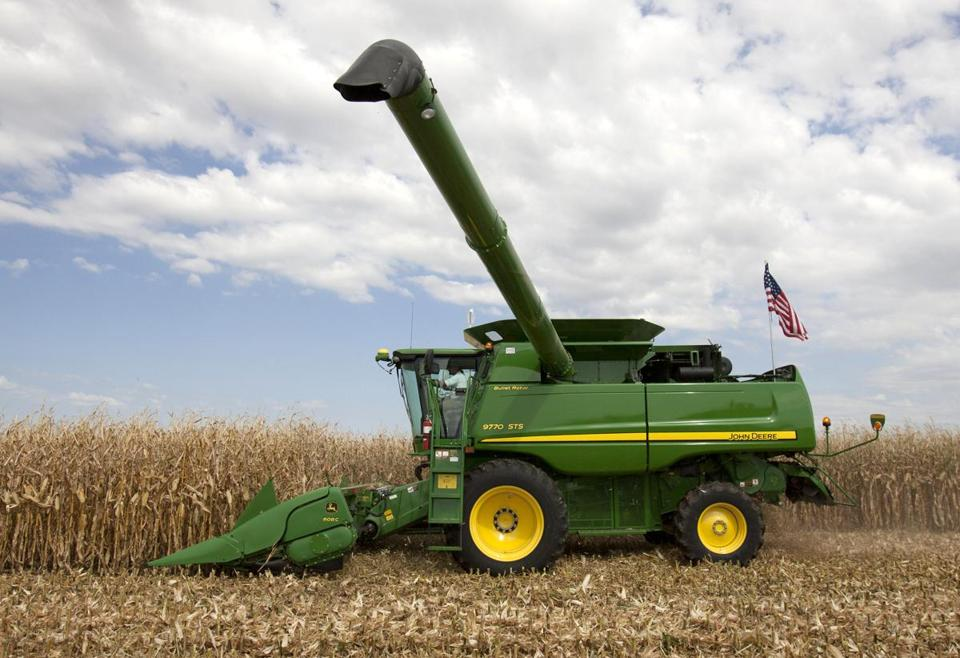 A John Deere combine demonstrates corn harvesting at the Husker Harvest Days agricultural fair in Grand Island, Neb., Wednesday, Sept. 15, 2010. (AP Photo/Nati Harnik)