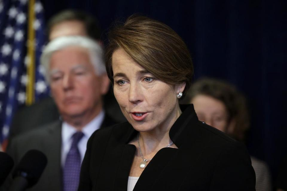Massachusetts Attorney General Maura Healey, center, takes questions from reporters as Martin Meehan, president of the University of Massachusetts, left, looks on during a news conference Tuesday, Jan. 31, 2017, in Boston. Healey is joining a lawsuit filed by the American Civil Liberties Union of Massachusetts challenging President Donald Trump's executive order on immigration. (AP Photo/Steven Senne)