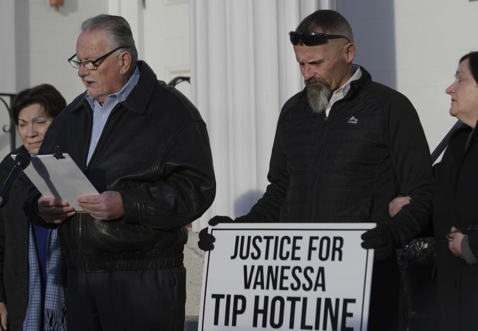 Steven Therrien, standing next to his wife Diega, aunt and uncle to Vanessa Marcotte, reads a statement outside the First Congregational Church in Princeton, Mass., Wednesday, Dec. 21, 2016. Vanessa's parents John Marcotte and Rossana Marcotte stand by. The family of Vanessa, a 27-year-old New York City woman, who was killed while out running near her mother's Massachusetts home is establishing a foundation in her name and renewing a call for the public's help in solving the case. (Christine Peterson/Worcester Telegram & Gazette via AP)