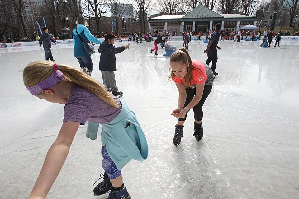 Robyn Wessman, 12, of Belmont, scooped up melting ice water at the Boston Common's Frog Pond on Friday.