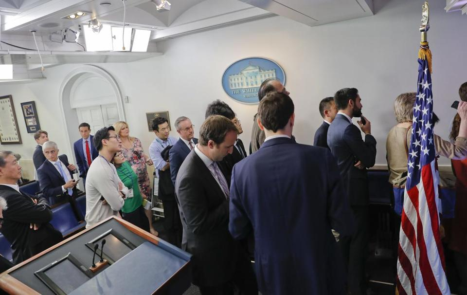 Reporters line up in hopes of attending a briefing in Press Secretary Sean Spicer's office at the White House in Washington on Friday.