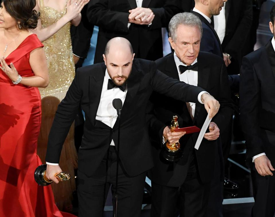 """La La Land"" producer Jordan Horowitz held up the card naming the winner for best picture at Sunday's Academy Awards — ""Moonlight."" That was after ""La La Land"" had been announced as top picture."