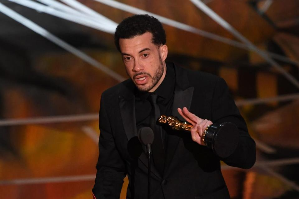 Oscar winner Ezra Edelman (pictured at the Academy Awards in February) will address the Ivy Film Festival at Brown University in April.