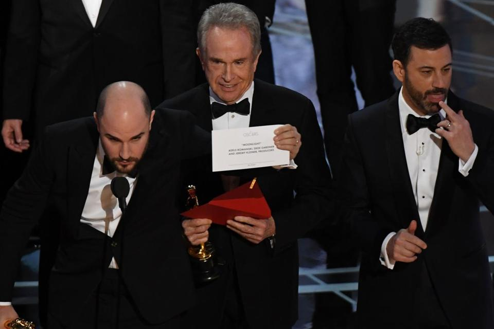 "Caption from AFP is not correct and has been edited above: Warren Beatty showed the card reading Best Film ""Moonlight"" next to ""La La Land"" producer Jordan Horowitz (left) and host Jimmy Kimmel."
