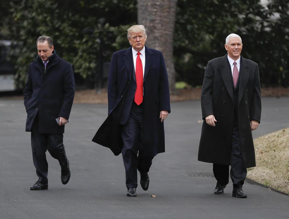 President Donald Trump, Vice President Mike Pence, right, and White House Chief of Staff Reince Priebus, left, walk together on the South Lawn of the White House in Washington to greet Harley Davidson Harley Davidson executives and union representatives. Thursday, Feb. 2, 2017. (AP Photo/Pablo Martinez Monsivais)