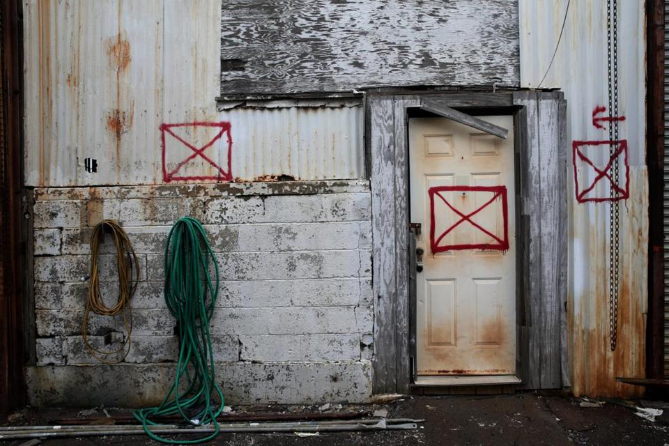 Boston, MA- March 01, 2017: An entrance to building 23/33 is marked as condemned at the Boston Harbor Shipyard in East Boston, MA on March 01, 2017. The Institute of Contemporary Art (ICA) plans to renovate the condemned former copper pipe shop.(Globe staff photo / Craig F. Walker) section: metro reporter: