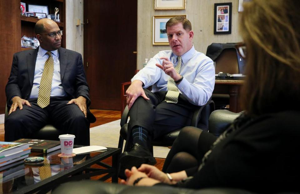 Mayor Walsh met with leaders of the city's biggest hospitals at City Hall, including Carney Hospital president Walter Ramos (left).