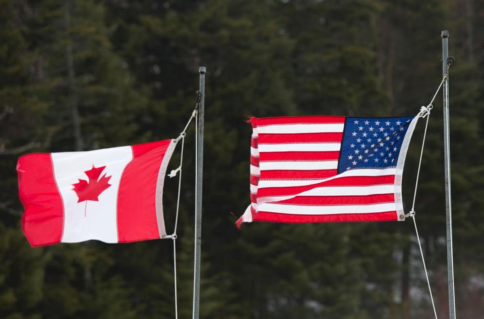 Canadian and American flags are seen at the US/Canada border March 1, 2017, in Pittsburg, New Hampshire. / AFP PHOTO / Don EMMERTDON EMMERT/AFP/Getty Images