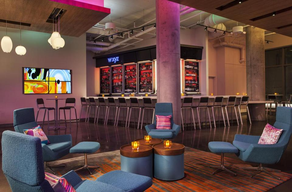 The bar at Aloft, a new hotel in the Seaport District, is a vibrant place to hang out.