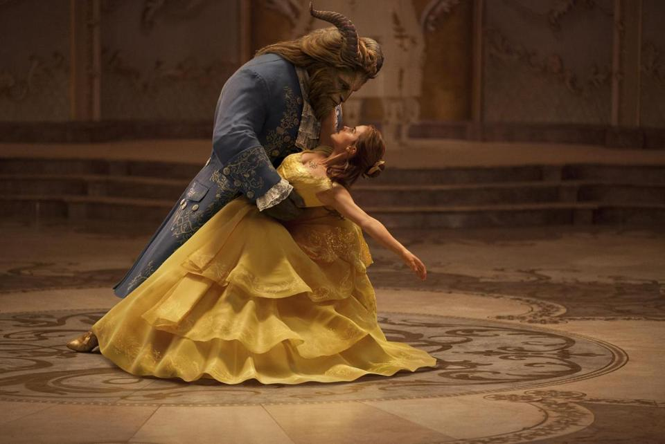 Emma Watson stars as Belle and Dan Stevens as the Beast in the 2017 film BEAUTY AND THE BEAST, directed by Bill Condon.