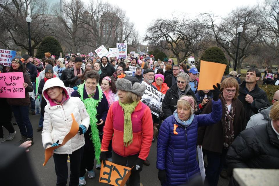 Women participated in the Boston version of the Women's March for America last month. A Day Without a Woman, set for Wednesday, encourages women to skip work and ditch domestic duties.