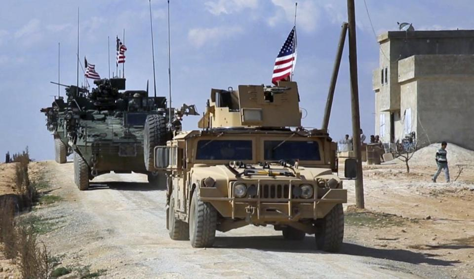 US forces seen on patrol on the outskirts of the Syrian town Manbij.