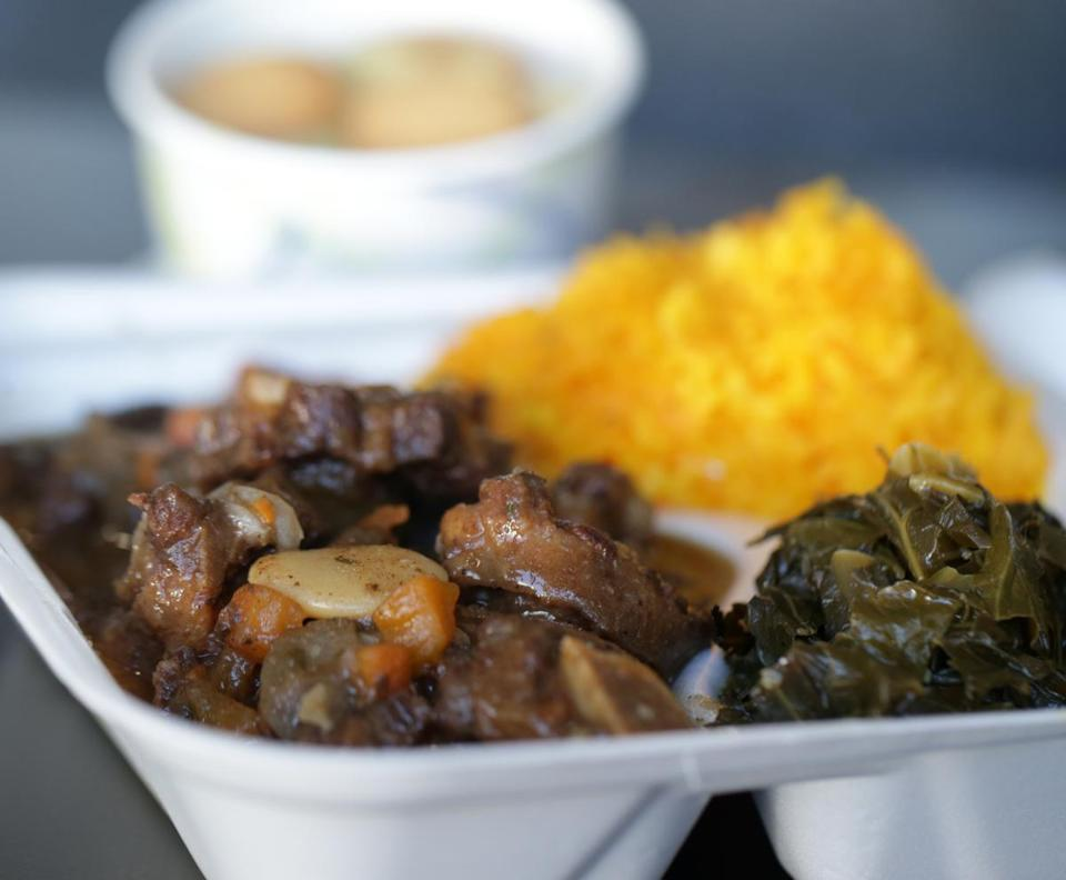 Oxtail dinner with yellow rice, collard greens, and banana pudding.