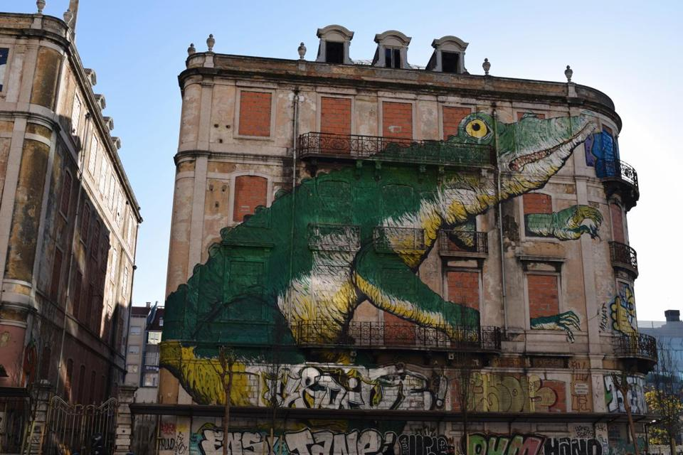 "Lisbon pulsates with ""urban art,"" abandoned buildings turned into large canvases like ""The Lizard."""