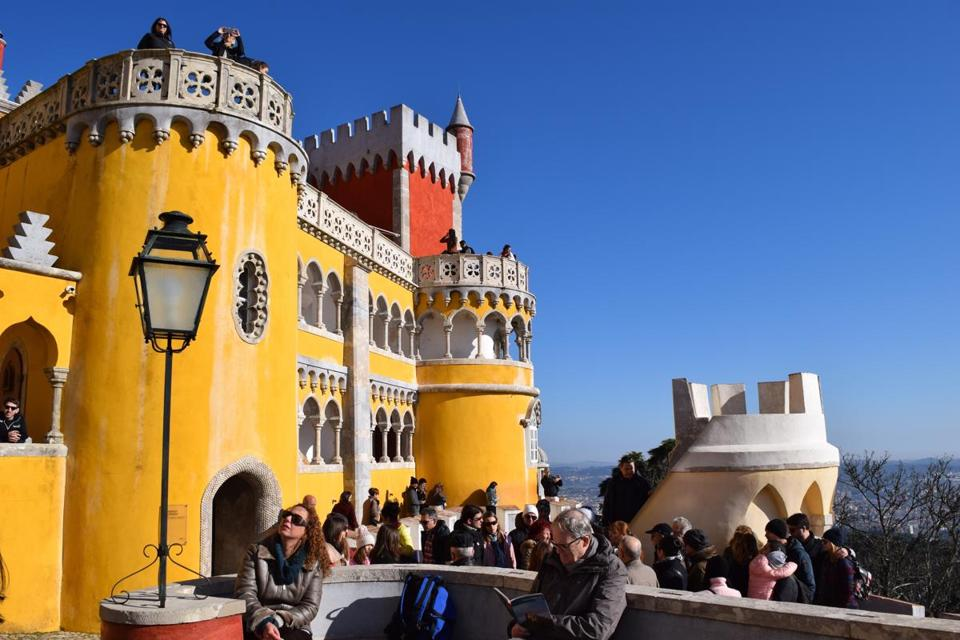 Pena Palace in the town of Sintra offers priceless views and playful, colorful architecture.