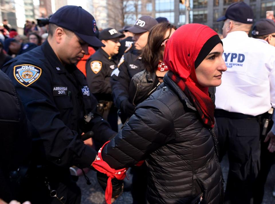 Woman are arrested by the New York City Police Department (NYPD) after sitting down in the street outside the Trump International Hotel and Tower in New York on March 8, 2017 during a #DayWithoutAWoman protest in New York City . / AFP PHOTO / TIMOTHY A. CLARYTIMOTHY A. CLARY/AFP/Getty Images