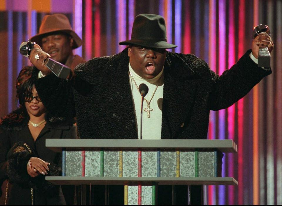 FILE--Notorious B.I.G., winner of rap artist and rap single of the year, clutches his awards at the podium during the annual Billboard Music Awards in New York Wednesday evening, Dec. 6, 1995. The rapper, whose real name was Christopher Wallace, was gunned down in Los Angeles as he left a party early Sunday, March 9, 1997, police said. Wallace, 24, was reportedly attending a party at the Petersen Automotive Museum in celebration of Friday s 11th Annual Soul Train Music Awards. (AP Photo/Mark Lennihan, File) -- Library Tag 03032002 Arts & Entertainment -- Library Tag 09072002 National-Foreign Library Tag 07212005 Living/Arts