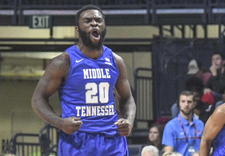 Middle Tennessee guard Giddy Potts (20) reacts to making a three point basket during an NCAA college basketball game against Mississippi in Oxford, Miss. on Wednesday, Nov. 30, 2016. (Bruce Newman, Oxford Eagle via AP)
