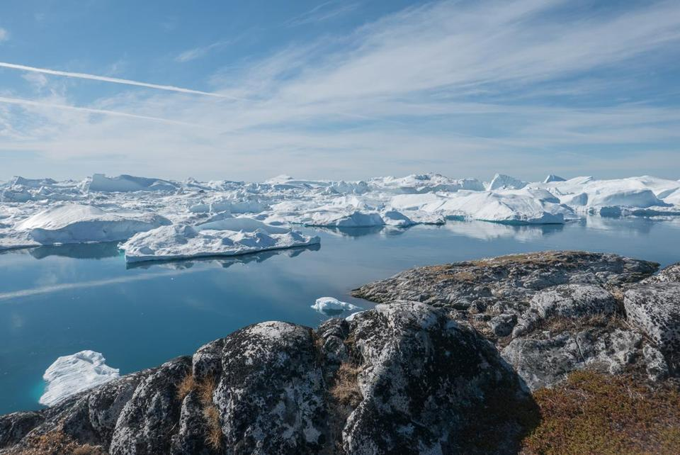 Large icebergs floated at the sea mouth of Ilulissat Icefjord.