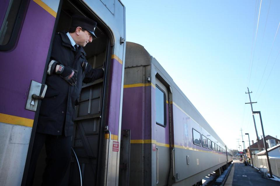 Andover, MA 01/05/2016 – A conductor watches as a train pulls out of the Andover Station in Andover, MA, on January 05, 2015. An out-of-service commuter rail train bound for Haverhill derailed early Tuesday morning in Lawrence when the track failed, sending three of the passenger cars off the tracks and causing major delays and cancellations for commuters north and west of Boston.(Globe staff photo / Craig F. Walker) section: metro reporter: boghosiana