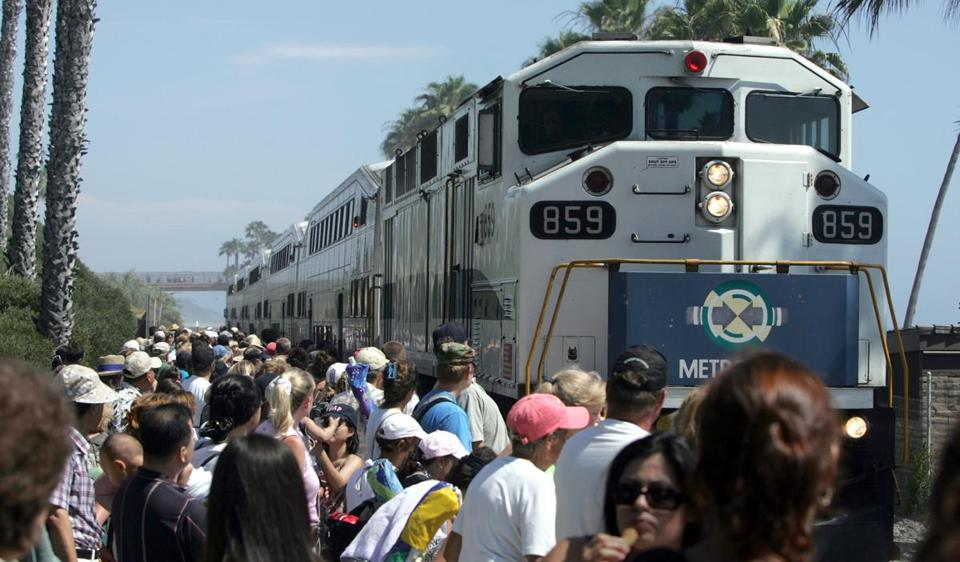16commuterrail - July 15, 2006. Riders board the weekend Metro Train in San Clemente. The train is bound for the inland empire. Expanded weekend service for Metrolink started today with riders leaving from the Riverside area to the beach at San Clemente. (Glenn Koenig/Los Angeles Times)