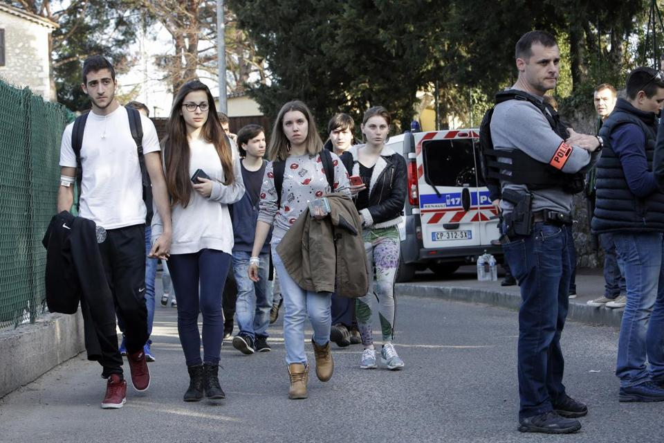 French sudents leave their high school Thursday after a shooting attack, allegedly by a fellow student.