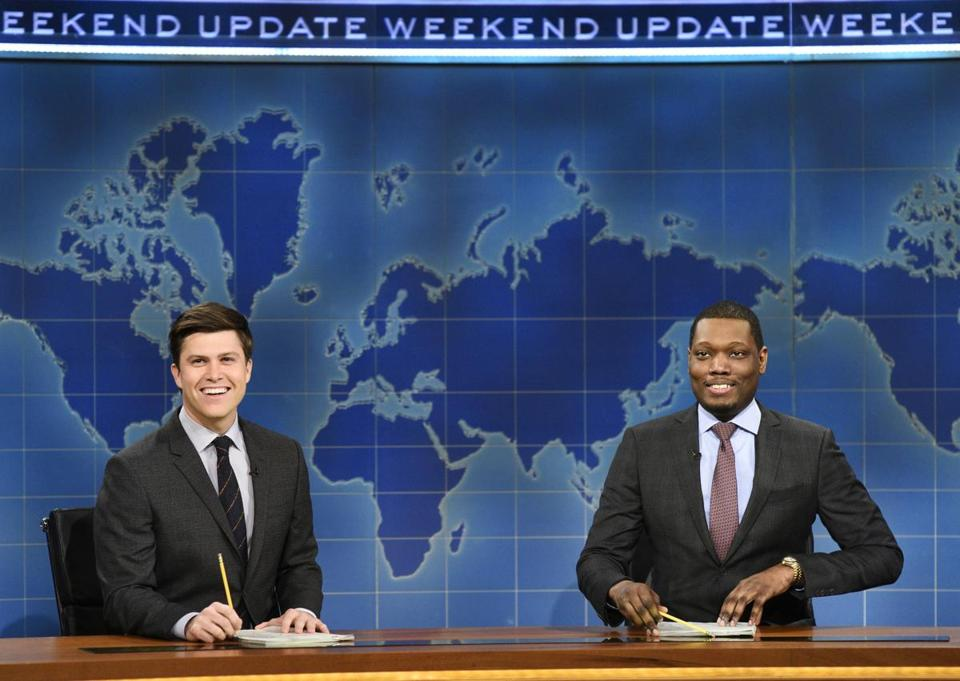 "In this March 4, 2017 photo provided by NBC, Colin Jost and Michael Che, right, appear during Weekend Update segment of ""Saturday Night Live"" in New York. ""Saturday Night Live"" will broadcast live simultaneously across the U.S. for its final four shows of the season, NBC announced Thursday, March 16. Until now, viewers in the Mountain and Pacific time zones have seen the show not as it aired ""live from New York,"" but on tape delay. The new live-for-all policy will apply to episodes telecast April 15, May 6, 13 and 20. (Will Heath/NBC via AP) 18crit"