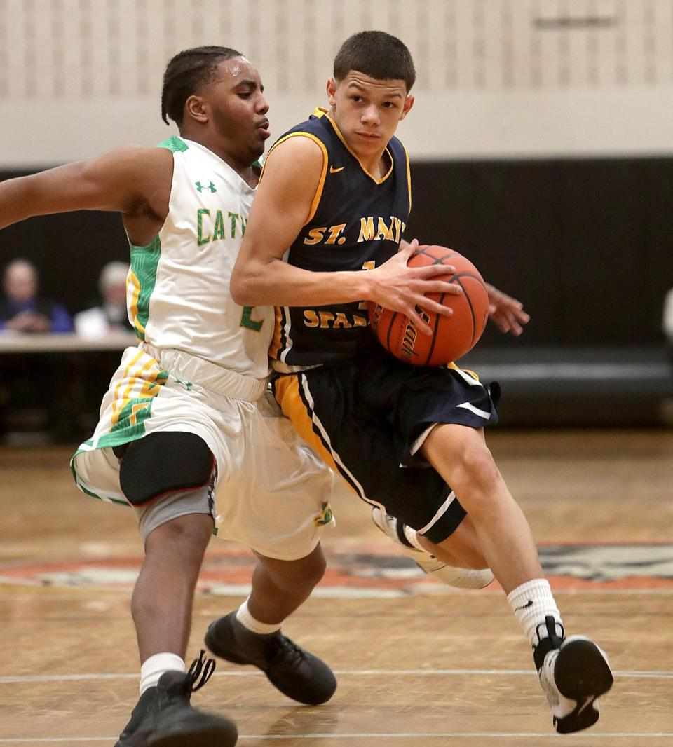 "A talented point guard on the St. Mary's boys' basketball team, Jalen Echevarria (1) said football was the sport he first loved. ""At first I was nervous trying a new sport, but it all came back to me,"" he said."