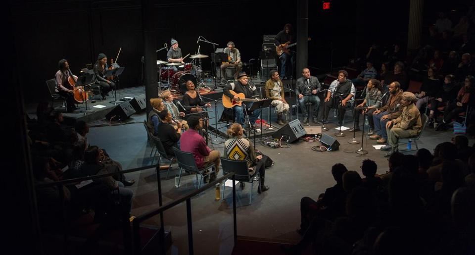 "Toshi Reagon (seated in front, with guitar) and company in Octavia E. Butler's ""Parable of the Sower: A Concert Performance."""