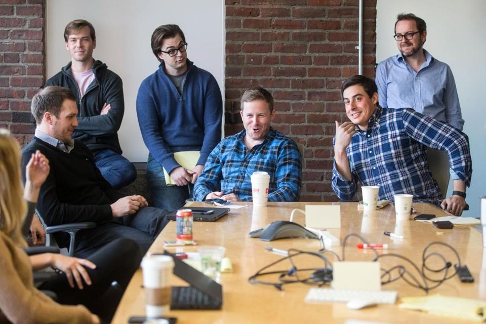04/11/2016 BOSTON Co-founders Patrick Petitti (cq) (sitting left) and Rob Biederman (cq) (sitting right) spoke with employees during an office meeting at HourlyNerd (cq) in Boston. (Aram Boghosian for The Boston Globe)