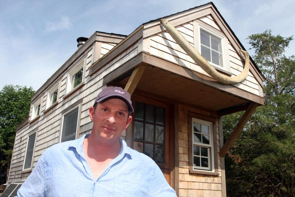"Isaiah Stover outside his ""tiny house"" off Cato Lane on Nantucket. Note: These photos are not to be published until after they appear in print in Address (Rob Benchley for The Boston Globe)"