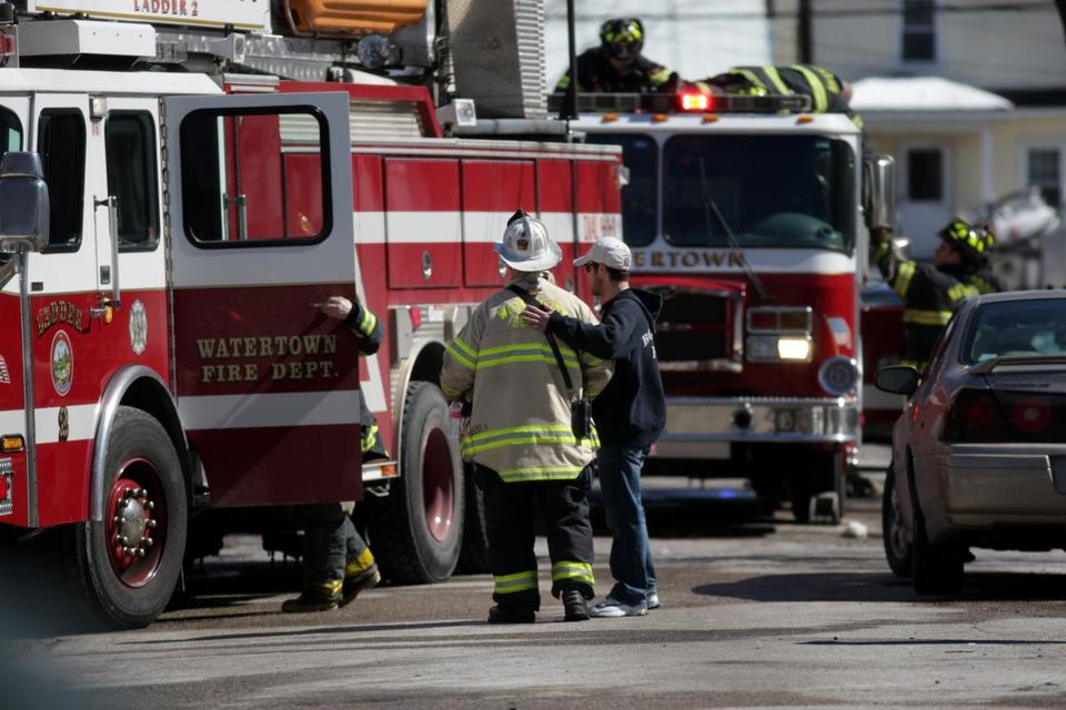 Watertown Ma 03/17/2017 A somber scene at Fire scene aftermath at 29 Merrifield Avenue in Watertown.Jonathan Wiggs /GlobeStaff) Reporter:Topic