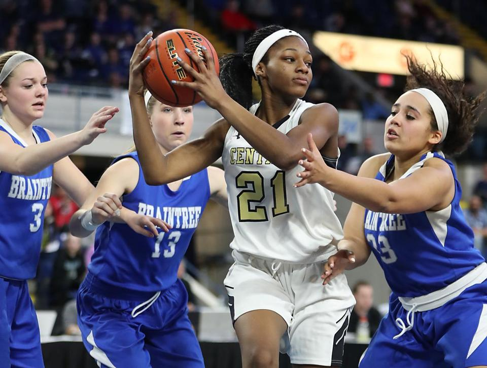 Springfield MA 3/18/17 Springfield Central Golden Eagles MaKayla Rudder controls the ball with pressure from Braintree High Wamps Jenna Roche (3), Rachel Tutkus (13) and Keelah Dixon (23) during second half action of the 2017 MIAA Girls Division 1a State Finals at MassMutual Center. (Photo by Matthew J. Lee/Globe staff) topic: reporter: