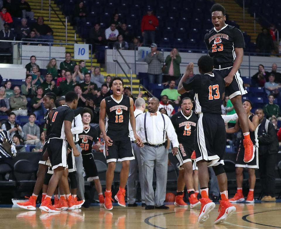 Springfield MA 3/18/17 Brighton High School Bengals players celebrate their 82-58 victory over Nashoba High Chieftains during the 2017 MIAA Boys Division 2 State Finals at MassMutual Center. (Photo by Matthew J. Lee/Globe staff) topic: reporter: