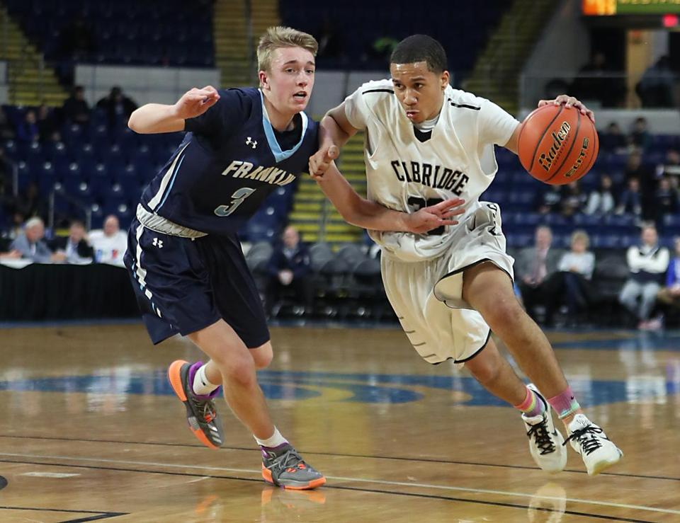 Cambridge's Malik Correia drove to the basket while being pressured by Franklin's Chris Edgehill.