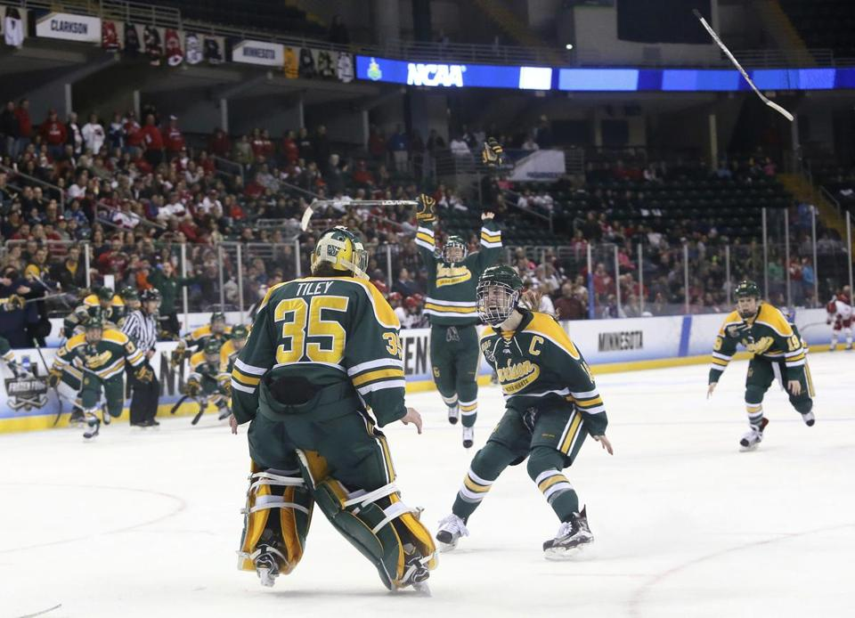 Cayley Mercer joined goalie Shea Tiley to celebrate after Clarkson beat Wisconsin.